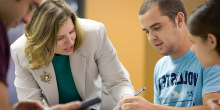 The amazing Dr. Lisa Forbes helping a business student during class